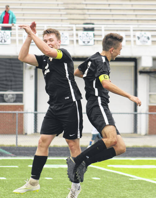 Drew Batson (left) and Caleb Perry celebrate after one of three goals on the night by Perry during Miami Trace's 3-0 win over Hillsboro Tuesday, Sept. 11, 2018 at Miami Trace High School.