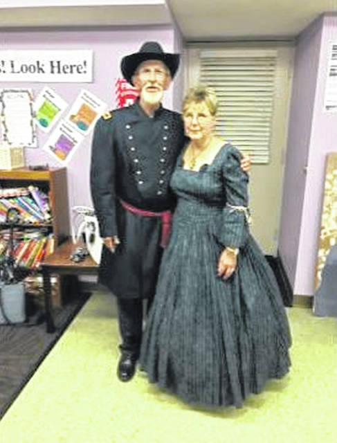 Ron Salmon in uniform as Col. Benjamin P. Runkle and Carol Salmon, dressed as she would have been in 1863 during the Civil War, were on hand for the latest Fayette County Genealogical Society meeting.