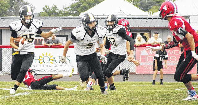 Miami Trace's Caden Sweitzer (35) returns a punt during a non-conference game at Logan Elm High School Friday, Sept. 7, 2018. Also pictured for the Panthers are Joshua Gilmore (9) and Luke Henry (52).