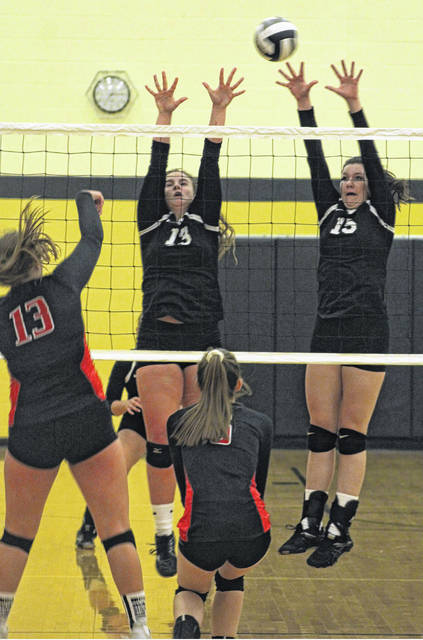 Miami Trace's Delaney Eakins (13) and Tapanga Sanderson (15) go for the block during a non-conference match against Logan Elm Wednesday, Sept. 5, 2018. The match was played at the Miami Trace Elementary School.